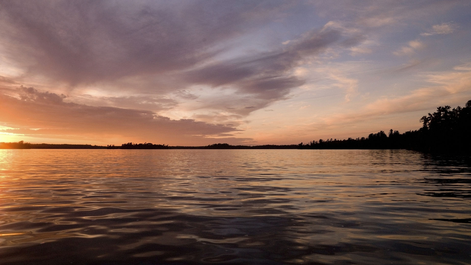 Lake of the Woods, Ontario, Canada; Twilight over still lake water